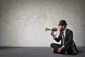 Vintage looking man shouting with a megaphone